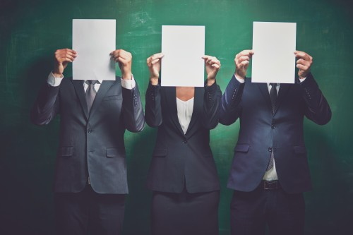 Elegant business partners holding blank papers on green background