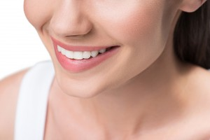Smiling young woman with perfect white teeth